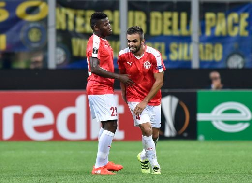 Hapoel Beer's Miguel Vitor celebrates scoring their first goal with Lucio Maranhao against Inter. REUTERS
