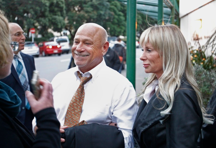 """Music composer Jeff Bass leaves a courtroom in Wellington, New Zealand. Bass, who composed the opening guitar riff for Eminem's song """"Lose Yourself,"""" was testifying in a copyright case. AP"""