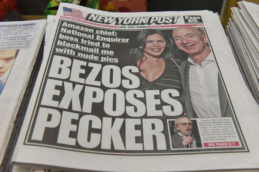 The New York Post with a headline referring to Jeff Bezos is photographed at a convenience store in New York City. - AFP