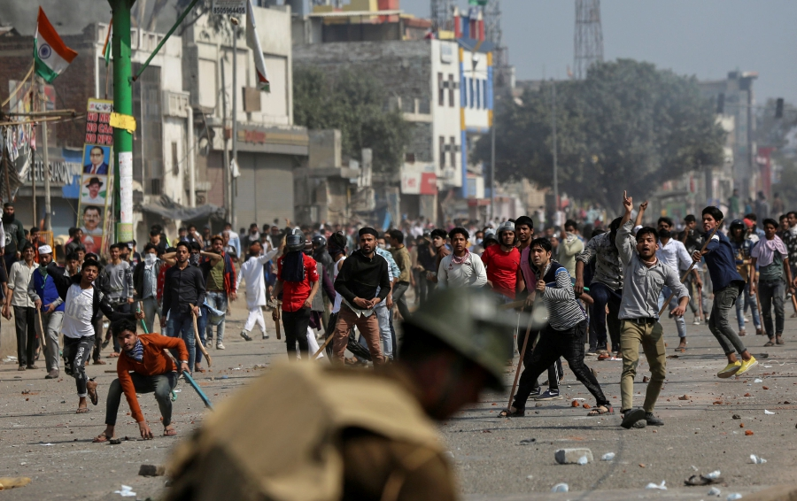 Demonstrators opposing new citizenship law throw pieces of bricks towards riot police and those supporting the law, during a clash in New Delhi, India. - REUTERS/File pic