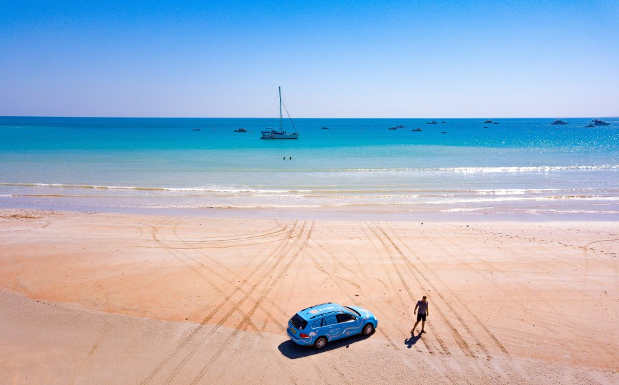 """In this undated handout photo taken on July 20, 2018 and released on April 7, 2019 from Dutch driver Wiebe Wakker shows him on Cable Beach in Broome, Western Australia with his retrofitted station wagon nicknamed """"The Blue Bandit"""" during his round-the-world trip in the electric car. - Wakker arrived in Sydney on April 7, 2019 after driving some 95,000 kilometres (59,000 miles) across 33 countries in what he said was the world's longest-ever journey by electric car. AFP"""