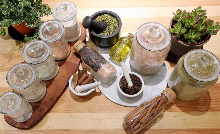 The sisters blend herbs and spices for their skincare products.