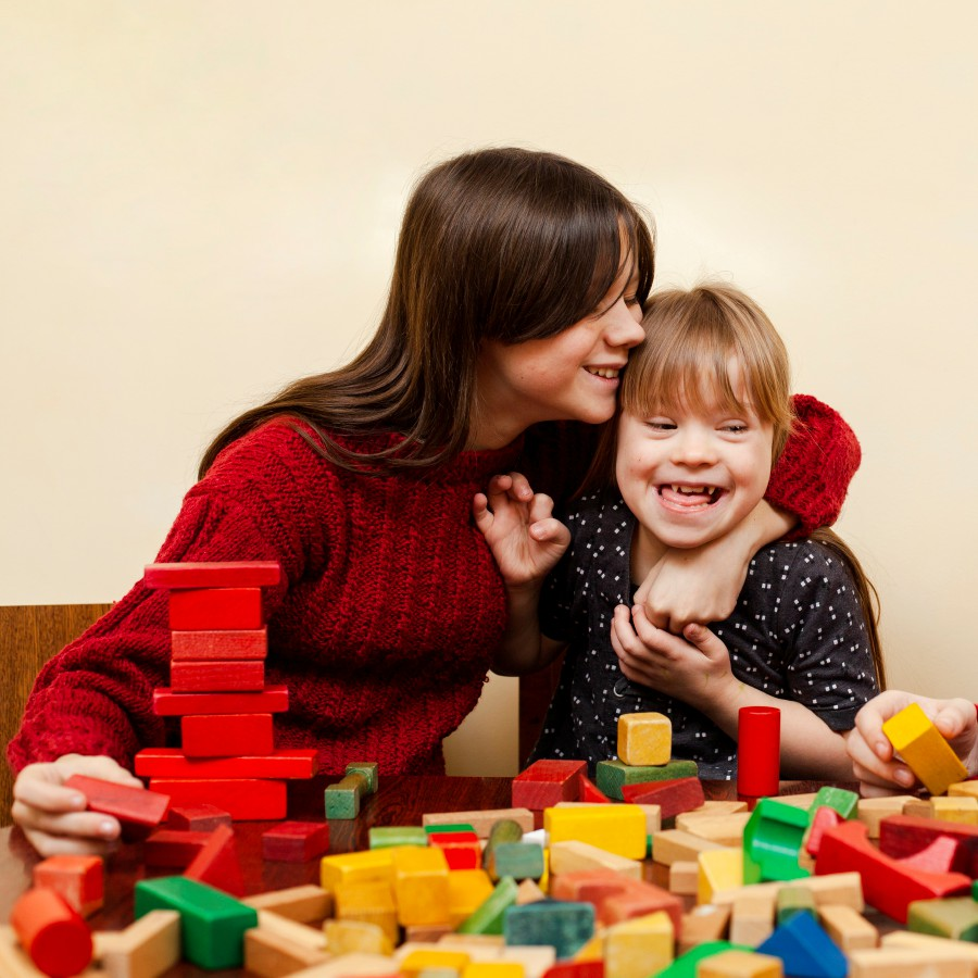 Parents/caregivers play a significant role in the lives of children with Down's Syndrome. Picture:Designed by senivpetro / Freepik.Designed by Freepik.