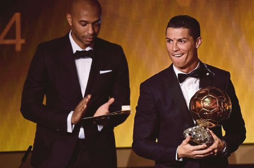 Portugal forward Cristiano Ronaldo named as the country's player of the century. The award comes after Ronaldo secured his third Ballon d'Or award on Monday. AFP Photo.