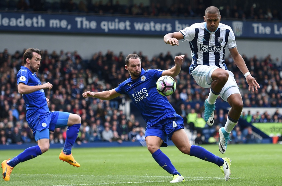 West Bromwich Albion's striker Salomon Rondon (right) vies for the ball with Leicester City's midfielder Danny Drinkwater and Leicester City's defender Christian Fuchs (left). AFP
