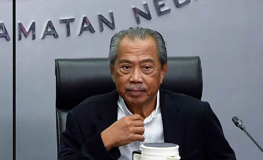 Prime Minister Tan Sri Muhyiddin Yassin chairing the COVID-19 Coordination Meeting. -File pic via BERNAMA