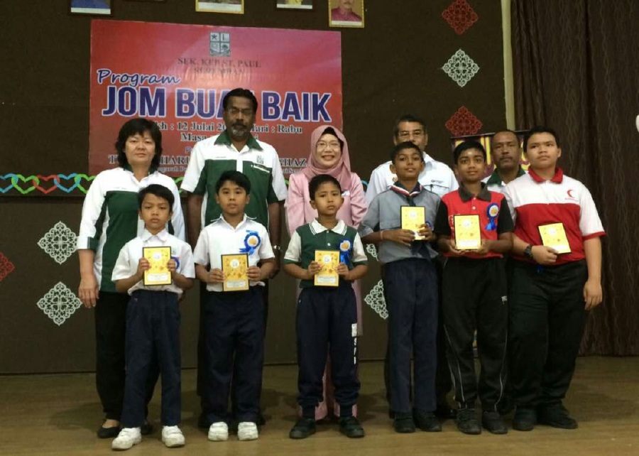 Headmaster Santhana Samy Amaladaf (second, left, back row) said the school's main objective is to educate its students that bullying is not acceptable and to teach them how best to handle the situation when they are bullied. (Pic courtesy of SK St Paul)
