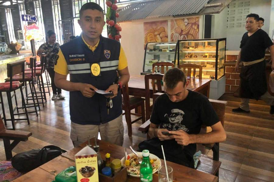 Russian Alexey Safronenkov, seated, is caught on Koh Samui in Surat Thani province for overstaying his visa by 2,861 days. - Pic courtesy of PRESS Fire And Rescue Facebook page/ Bangkok Post