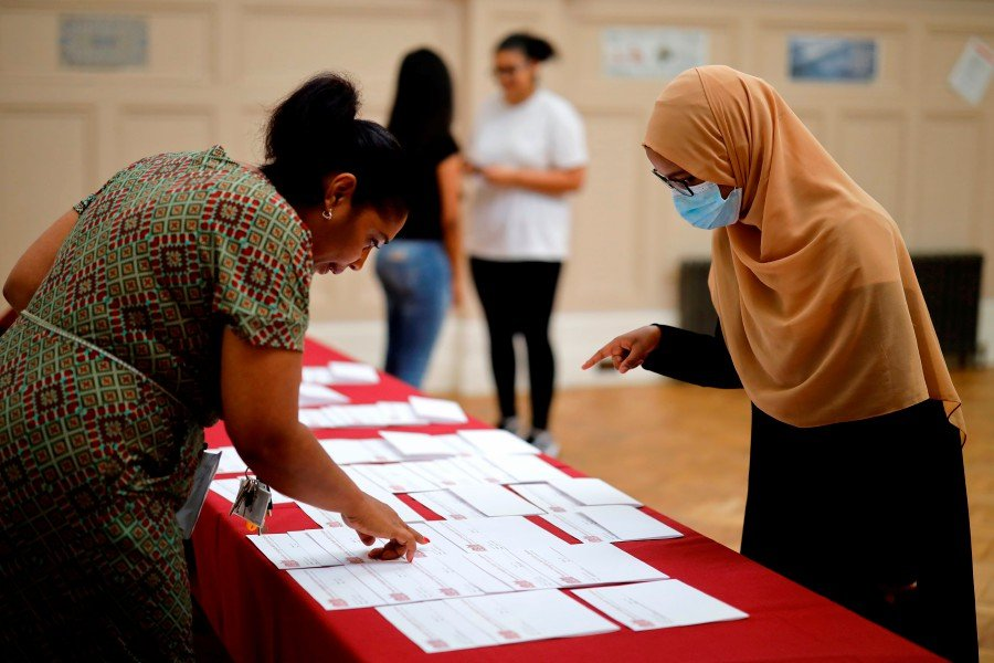 Students receiving their A-Level results in east London on Aug 13. -- Pix: AFP FILE PIX (Pic for representational purposes only)