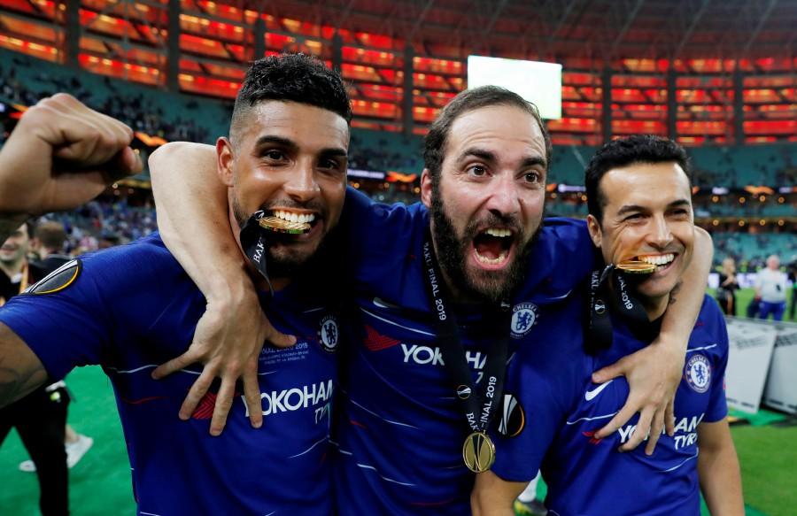 Chelsea's Emerson Palmieri, Gonzalo Higuain and Pedro pose with their medals as they celebrate winning the Europa League. - Reuters