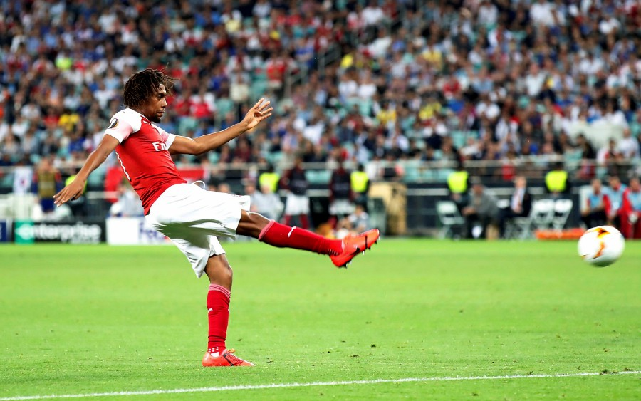 Arsenal's Alex Iwobi scores their first goal against Chelsea. - Reuters