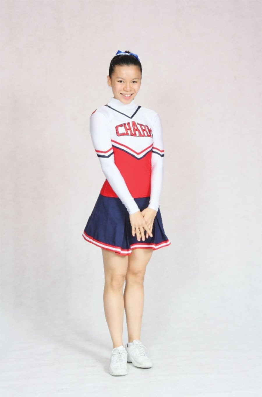 Tan during her cheerleading days.