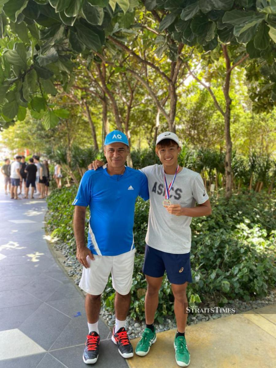 Christian Didier Chin (right) with his coach Saeed Afzalirad. PIC COURTESY OF CHRISTIAN DIDIER CHIN