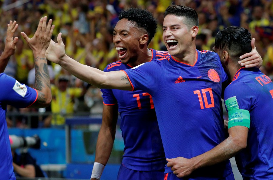 eb71b8f8824 ... Rodriguez (C) after scoring the 2-0 lead during the FIFA World Cup 2018  group H preliminary round soccer match between Poland and Colombia in Kazan  ...