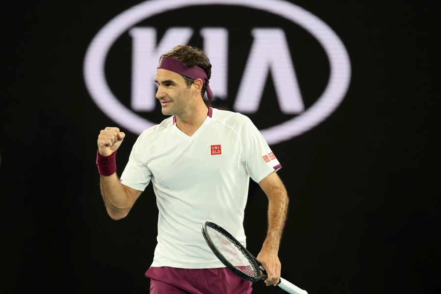 Switzerland's Roger Federer celebrates after victory against Hungary's Marton Fucsovics during their men's singles match on day seven of the Australian Open tennis tournament in Melbourne. (AFP)