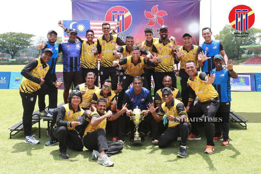 Malaysian cricket players celebrate with the trophy at Kinrara Oval today. PIC COURTESY OF CRICKET MALAYSIA