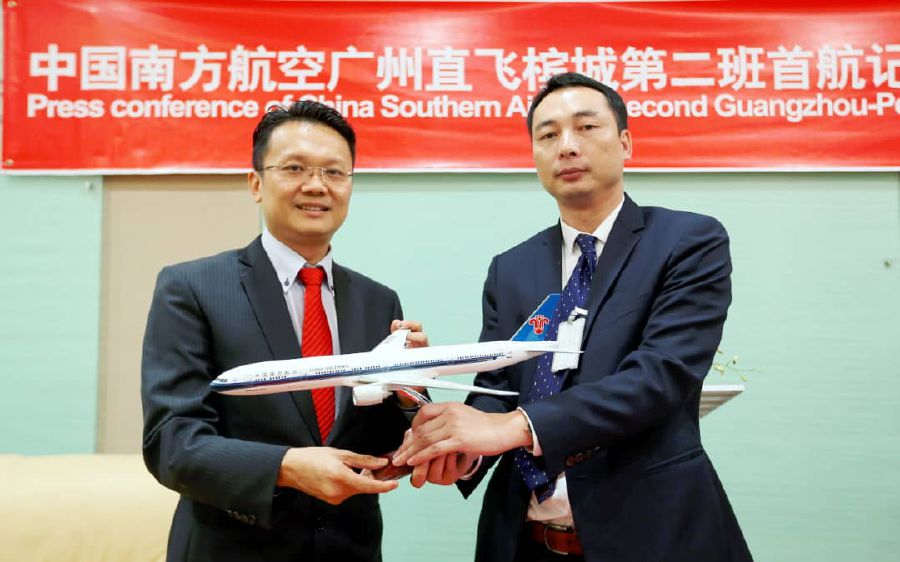 CSA Penang general manager Liu Zhen Hua (right) said that the flight frequency from Guangzhou, which is currently at one trip daily, would be doubled to two flights daily. — Pic by NSTP/MIKAIL ONG