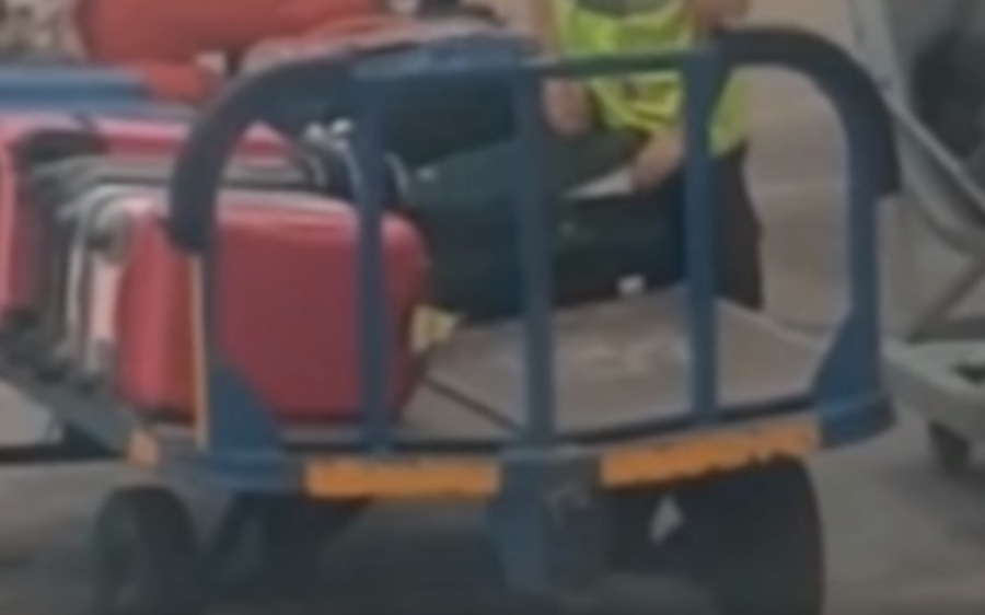 Watch: Baggage handler caught stealing from checked-in