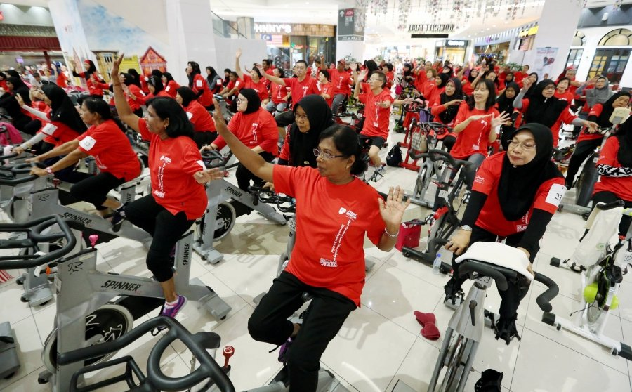"""""""In the name of health, senior citizens jump on exercise bikes"""""""