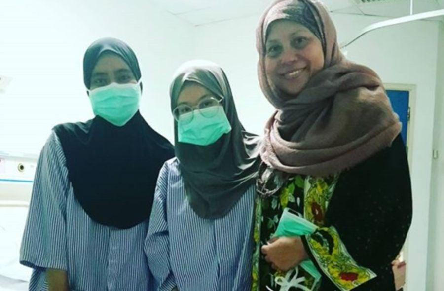 Dayangku Intan (right) and Wanku Intan Syarafana (centre) before she underwent her surgery earlier this month. — Instagram/Dayangku Intan