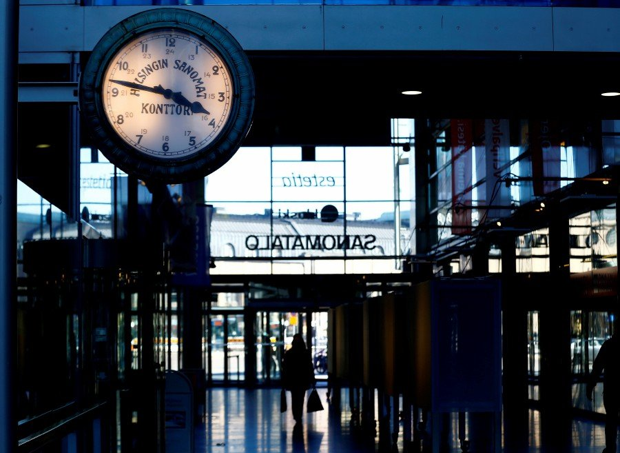 An old clock shows the time inside Sanoma House in Helsinki, Finland. -REUTERS pic