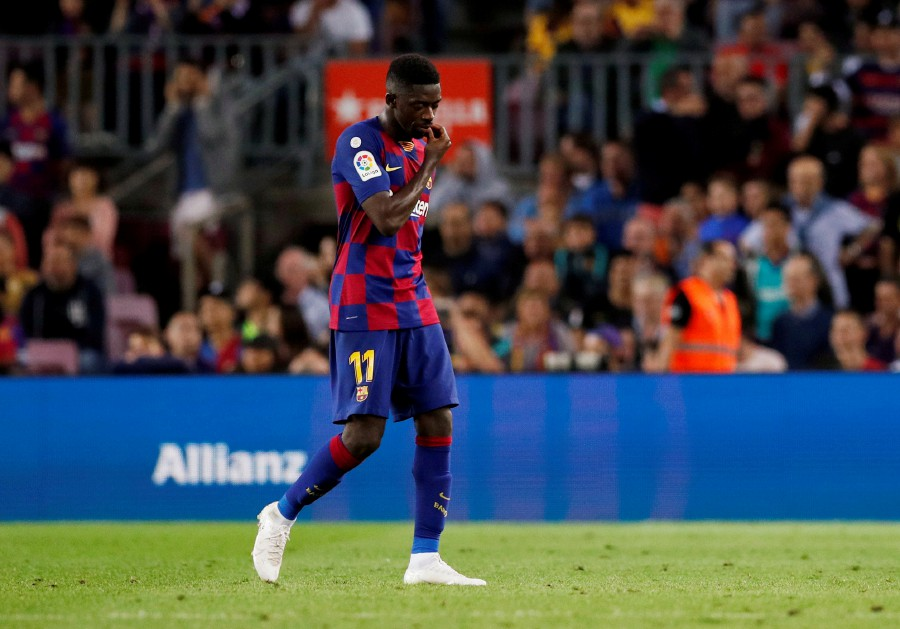 Barcelona's Ousmane Dembele after being sent off by referee Antonio Mateu Lahoz during the match against Sevilla at Camp Nou, Barcelona. - Reuters