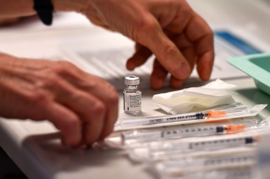 The government is due to announce the vaccine programme today. It must be clear, comprehensive and transparent. - AFP file pic