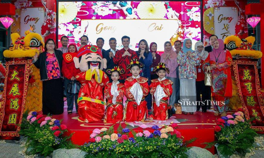 Malaysia Airports Holdings Bhd acting group chief executive officer Datuk Mohd Shukrie Mohd Salleh (seventh from left) with senior management team at the launch of Chinese New Year campaign at KLIA in Sepang, yesterday. NST pix by Luqman Hakim Zubir.