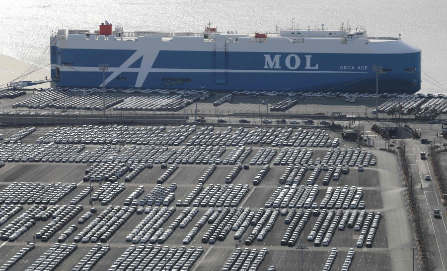 This picture taken on February 6, 2020 shows rows of Hyundai Motor cars parked for shipping in the southeastern port of Ulsan. (AFP)