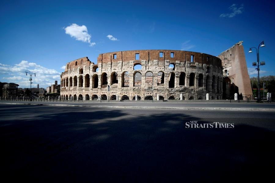 A general view shows a deserted road and the Colosseum monument on March 25, 2020 in Rome during the country's lockdown following the COVID-19 new coronavirus pandemic. -AFP pic