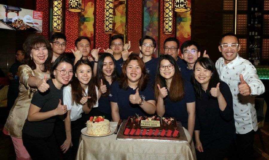 Sunway Education Group chief executive officer Dr Elizabeth Lee (second row, left), team captain Alicia Tay (first row, centre) and the Malaysia National Youth Culinary Team at the welcome home and celebratory dinner party held on March 6 for their win in the IKA/Culinary Olympics. With them is Sunway University head chef Patrick Siau (second row, right).