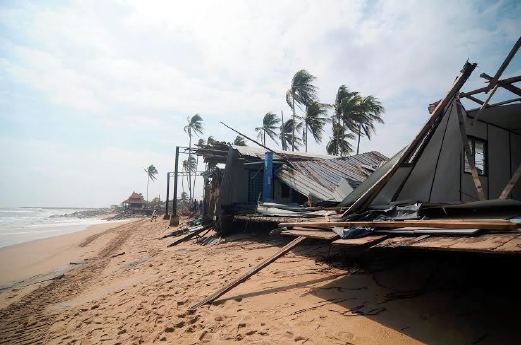 Several houses were badly damaged after being hit by waves in Tanjung Gelam, Mengabang Telipot. Pix by MOHD SYAFIQ AMBAK.