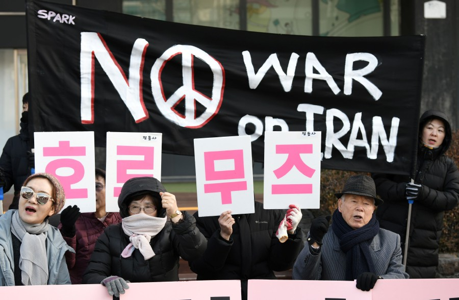 """South Korean activists hold placards reading """"No dispatch to Hormuz!"""" during a rally denouncing the government's decision to send troops to the Strait of Hormuz, near the US embassy in Seoul. - AFP"""