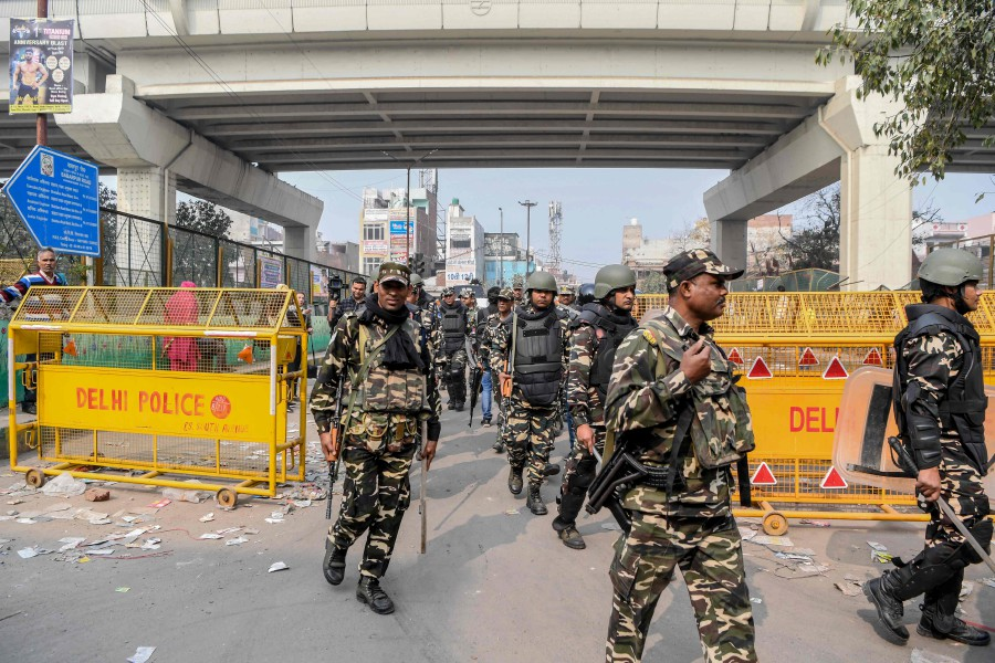 Security personnel patrol on a street following clashes between people supporting and opposing a contentious amendment to India's citizenship law, in New Delhi. -AFP
