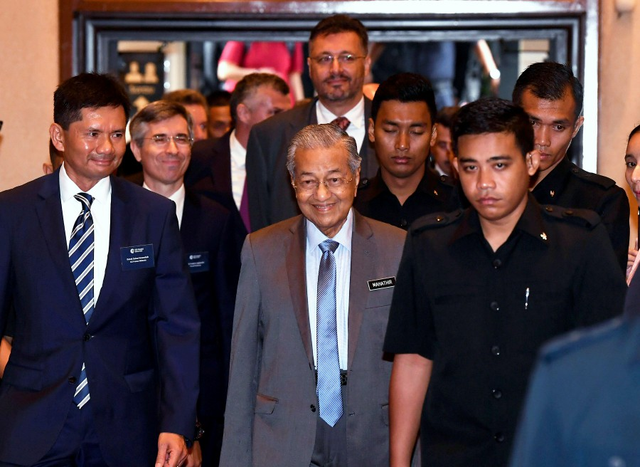 Prime Minister Tun Dr Mahathir Mohamad (centre) arrives to attend a dialogue session with the French business community in Malaysia organised by the Chamber of Commerce and Industry France Malaysia in Cyberjaya. - Bernama
