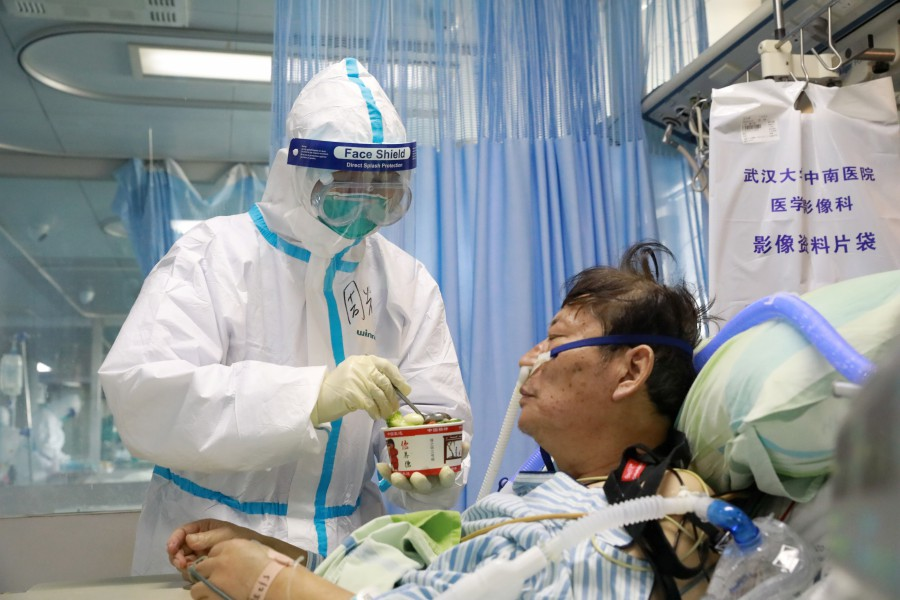 China says significant drop in coronavirus cases; death toll climbs to 1,665