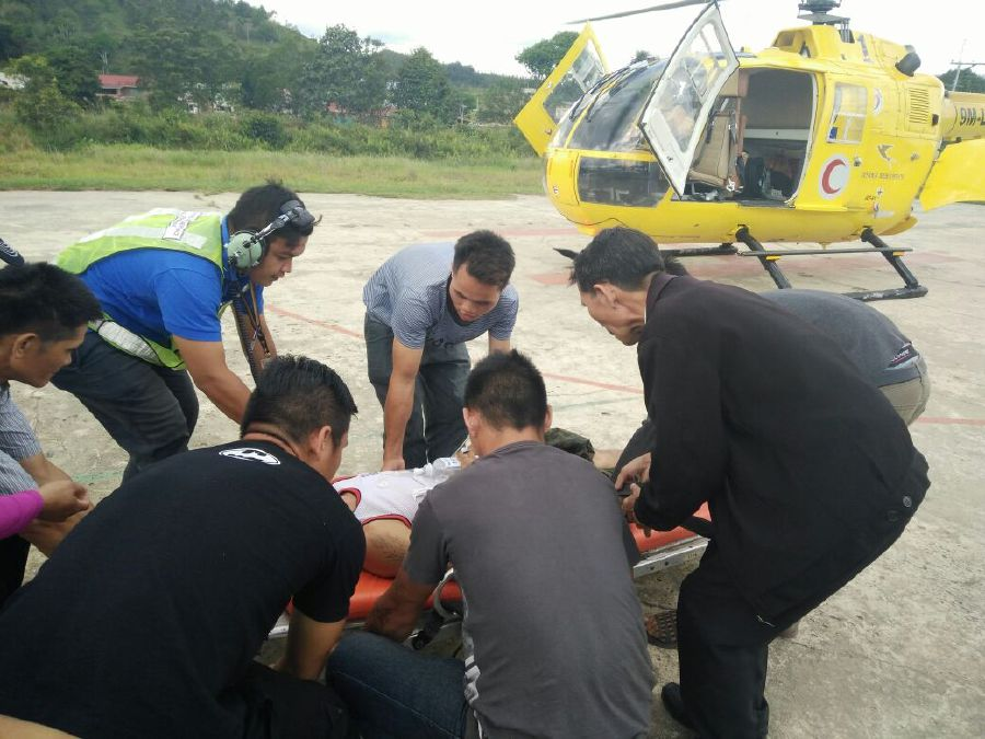 A patient with spinal injury lying on a stretcher ready to be airlifted