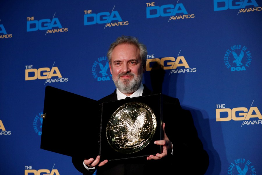 "Sam Mendes, director of ""1917"", holds his winning medallion for Outstanding Directorial Achievement in Theatrical Feature Film category at the 72nd Annual Directors Guild Awards in Los Angeles, California. -Reuters"