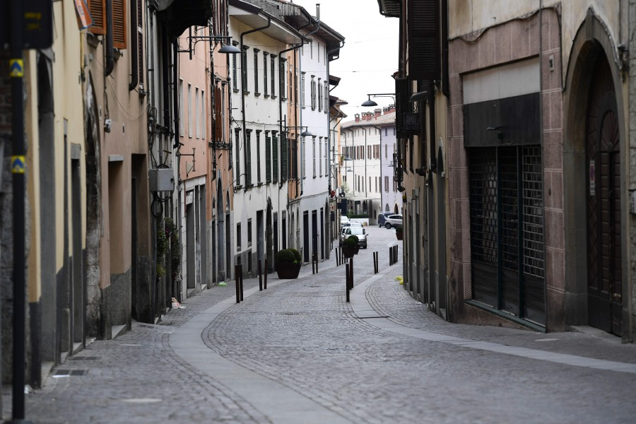 A general view shows a deserted street in Albino near Bergamo, Lombardy, on March 25, 2020, during the country's lockdown following the COVID-19 new coronavirus pandemic. - AFP pic