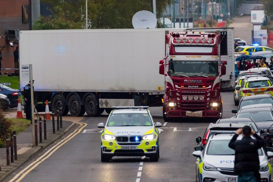 Police drive the lorry container along the road from the scene in Waterglade Industrial Park in Grays, Essex, Britain, 23 October 2019. A total of 39 bodies were discovered inside a lorry container in the early hours of this morning, and pronounced dead at the scene. - EPA/VICKIE FLORES