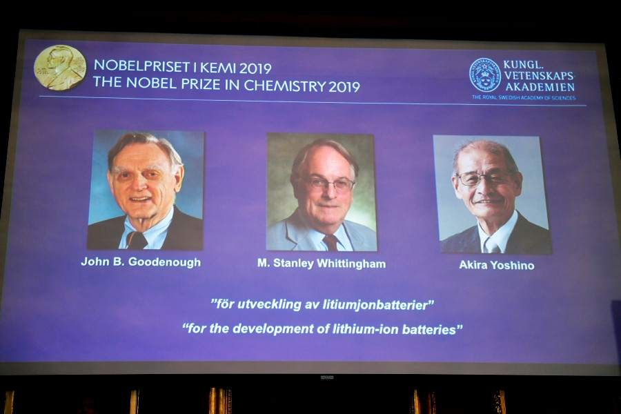 A screen displays the portraits of the laureates of the 2019 Nobel Prize in Chemistry (from left to right) John B. Goodenough, M. Stanley Whittingham, and Akira Yoshino 'for the development of lithium-ion batteries' during a news conference at the Royal Swedish Academy of Sciences in Stockholm, Sweden. - EPA