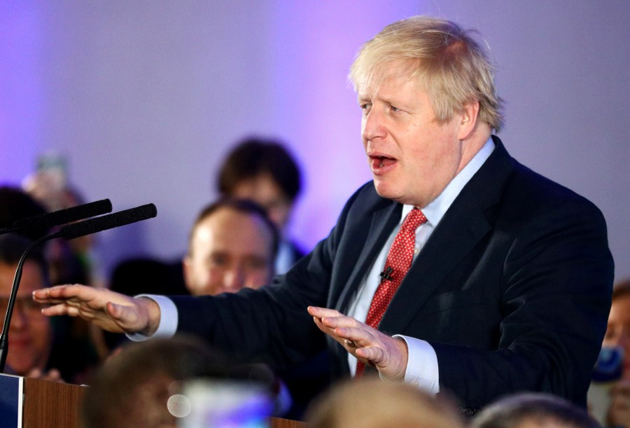 Britain's Prime Minister Boris Johnson gestures as he speaks during a Conservative Party event following the results of the general election in London. -Reuters