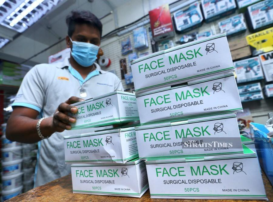 Suhail Rana, arranges the remaining boxes of facemasks at his shop in Bangsar. -NSTP/Intan Nur Elliana Zakaria
