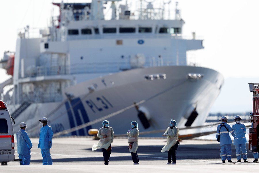 Medical personnel work near the cruise ship Diamond Princess, where dozens of passengers were tested positive for coronavirus, at Daikoku Pier Cruise Terminal in Yokohama, south of Tokyo, Japan. -Reuters