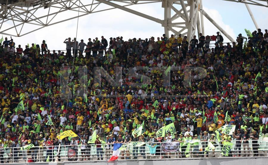The fans packing the Sepang International Circuit on Sunday for the Malaysia Motorcycle Grand Prix. Pic by