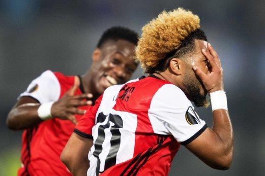 Feyenoord's Tonny Trindade (right) celebrates after scoring the winning goal against Manchester United in Rotterdam. Feyenoord won 1-0. EPA