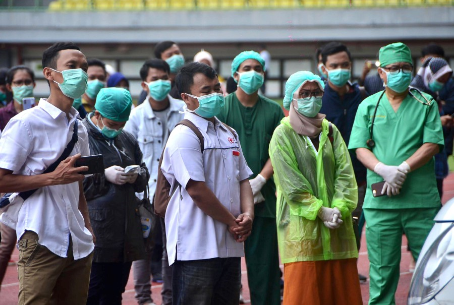 Indonesian medical staff take part in a mass test for the COVID-19 coronavirus at Patriot stadium in Bekasi, West Java. -REUTERS pic