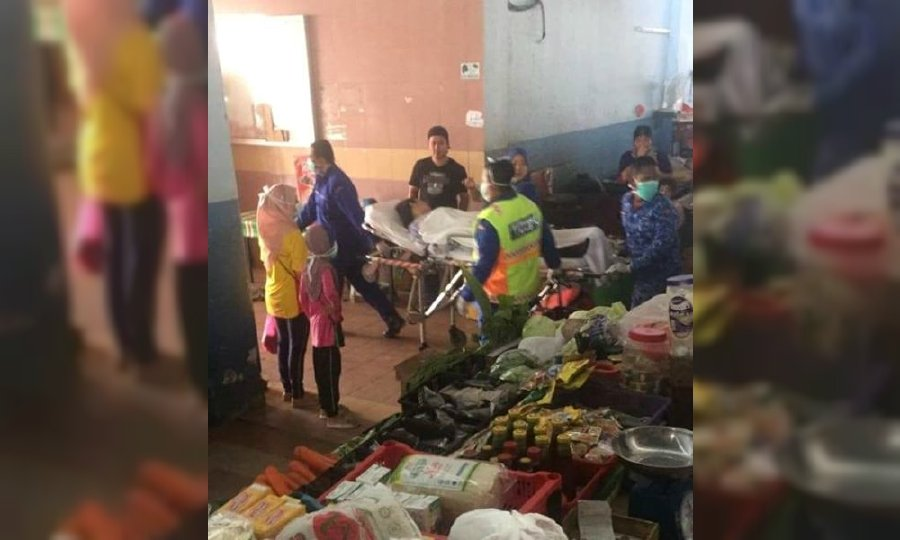 This image sourced from social media shows the woman is stretchered off at Sungai Besar market. - Pic source: Facebook//ILoveSgBesar
