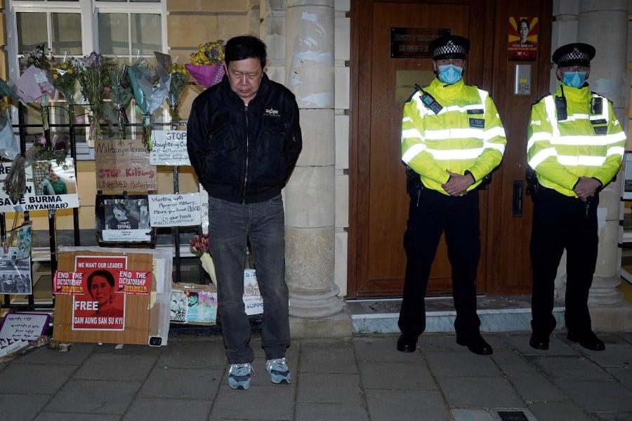 Myanmar's Ambassador to the United Kingdom, Kyaw Zwar Minn, stands locked outside the Myanmar Embassy in London. - AFP pic