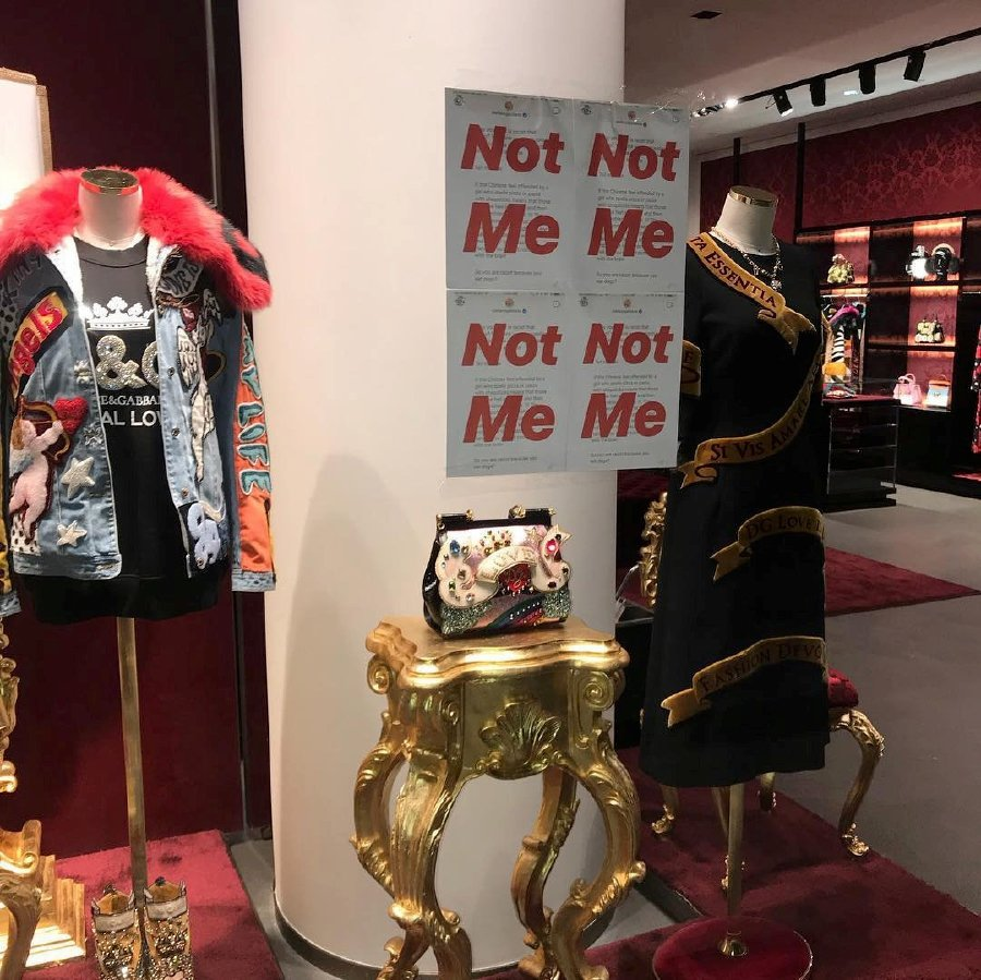 585c0c7e16 The prints of Stefano GabbanaÕs Instagram post having written 'Not Me' are  seen on a Dolce & Gabbana window store in Shanghai, China November 21, ...